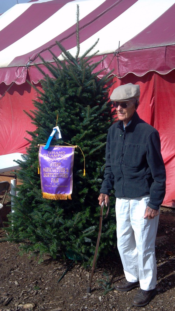 Sam Cartner poses with his grand champion tree at the Avery County Agriculture Fair.